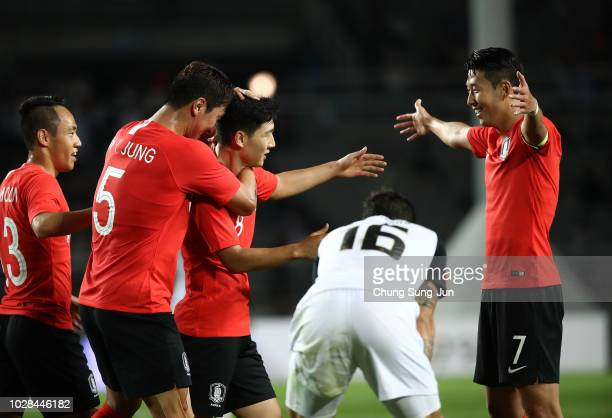 Nam Tae-Hee of South Korea celebrates with team mate Son Heung-min after scoring a second goal during the International Friendly match between South...