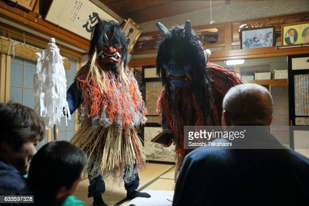 Namahage deities visiting a house during the Namahage festival of traditional folk event on New Year's Eve They shouting loudly to people Are there...
