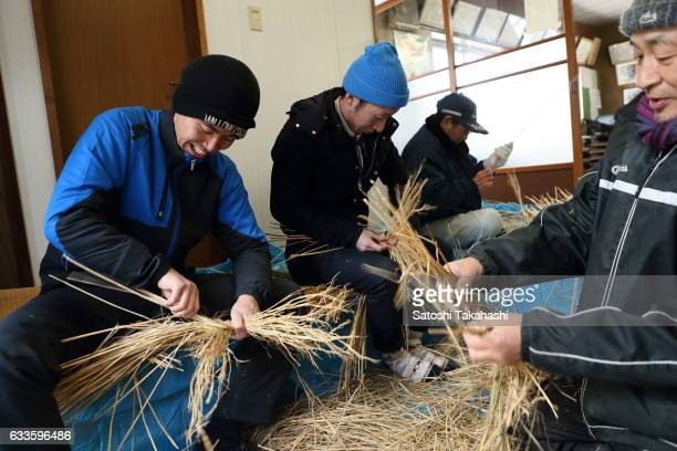 Namahage players make Kede which is traditional straw garment of Namahage on the day before the Namahage festival of traditional folk event on New...