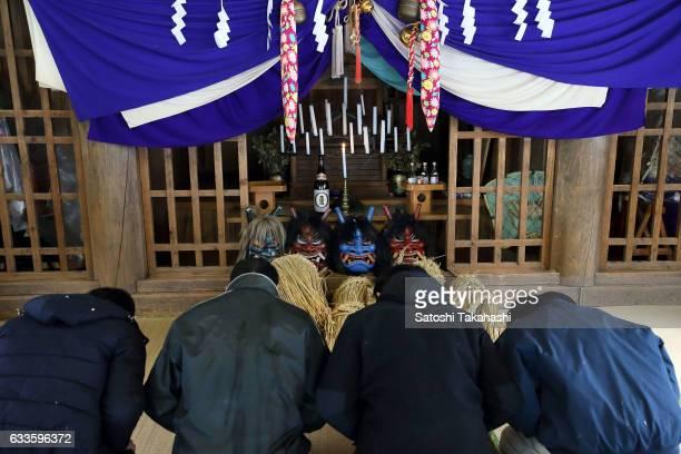 Namahage players pray to soul of Namahage in front of Namahage masks at Shinmei shrine on the day before the Namahage festival of traditional folk...