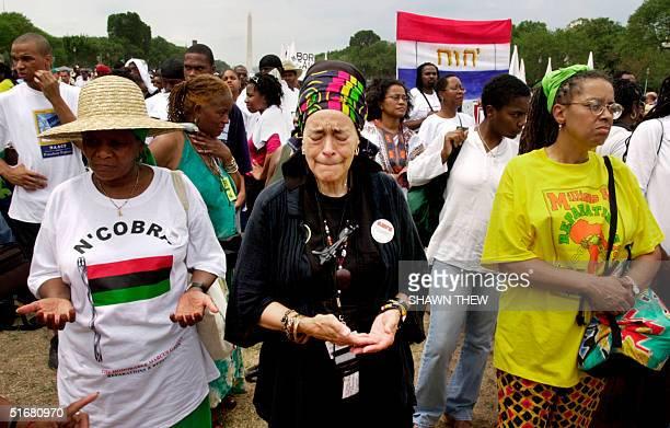 Namakula Tausi of Washington, with Nana Seshibe of South Africa and Deborjha Blackwell of Washington DC, prays in remembrance of her ancestors 17...