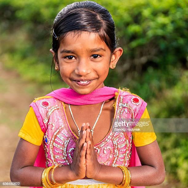 namaste! portrait of sri lankan little girl, nuwara eliya, ceylon - camellia sinensis stock photos and pictures