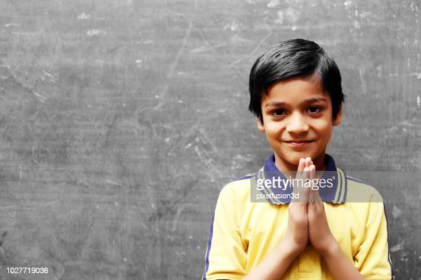 namaste! - portrait of young sherpa boy - place of worship stock pictures, royalty-free photos & images