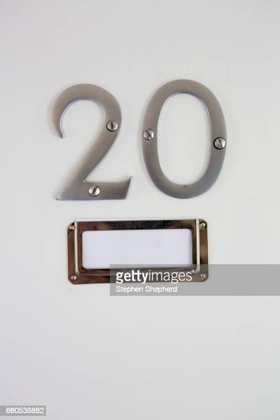 Name badge and number on the door.