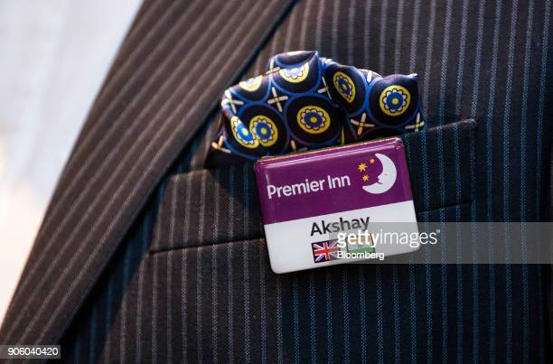 A name badge sits on suit jacket at a Premier Inn hotel operated by Whitbread Plc in London UK on Wednesday Jan 17 2018 The hotel and restaurant...