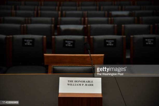 A name card marks the empty spot where Attorney General William Barr has refused to testify before the House Judiciary Committee about special...