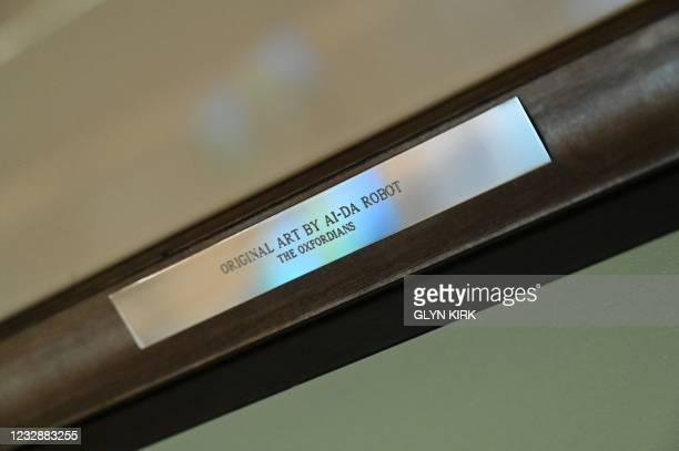 Name plate on the frame of a self-portrait created by the worlds first ultra-realistic AI robot artist, Ai-Da, who can draw, paint and is a...