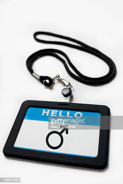 Name tag with a male symbol on it