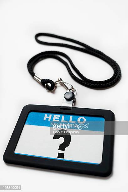 Name tag with a question mark on it
