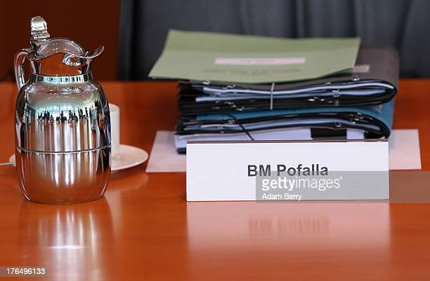 A nameplate and folders lie on a table at the seat belonging to German Chancellery Chief of Staff Ronald Pofalla prior to the weekly German federal...