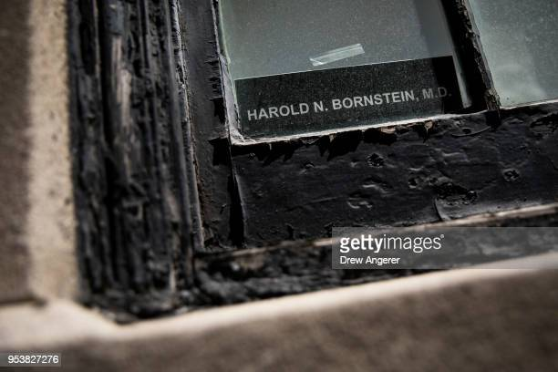 A nameplate sits in the window of the office of Dr Harold Bornstein who was previously President Donald Trump's longtime personal physician May 2...