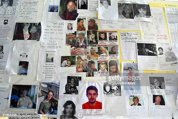 Names and photographs of missing people of the tsunami which hit the southern Thai coastline last weekend are pinned on a bulletin board at the...