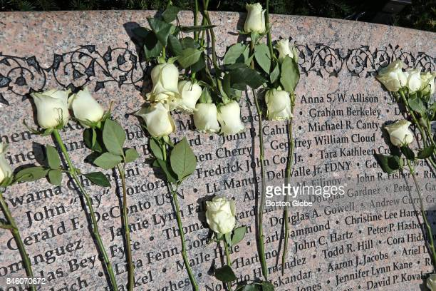 Names etched in stone and covered with flowers are pictured at the Boston Public Garden during ceremonies remembering victims of the 9/11/2001...