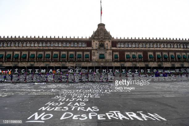 Names of feminicide victims, slogans and flowers intervene fences placed outside the National Palace ahead of demostrations as part of the...