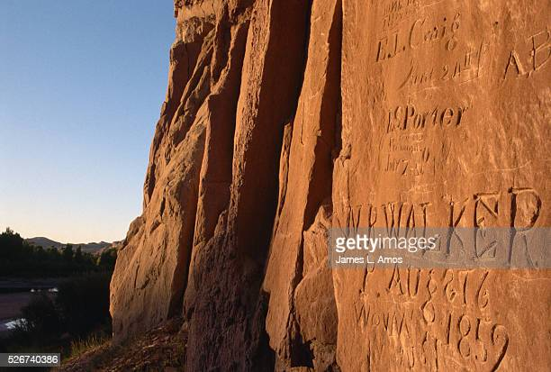 Names of pioneers who crossed the country along the Oregon Trail stand carved in a cliff at the Green River Crossing in Wyoming