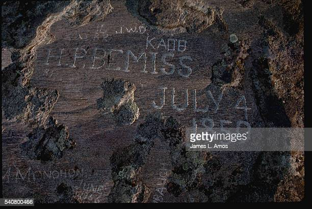 Names of pioneers who crossed the country along the Oregon Trail stand carved in Independence Rock near Casper Wyoming   Location near Casper Wyoming