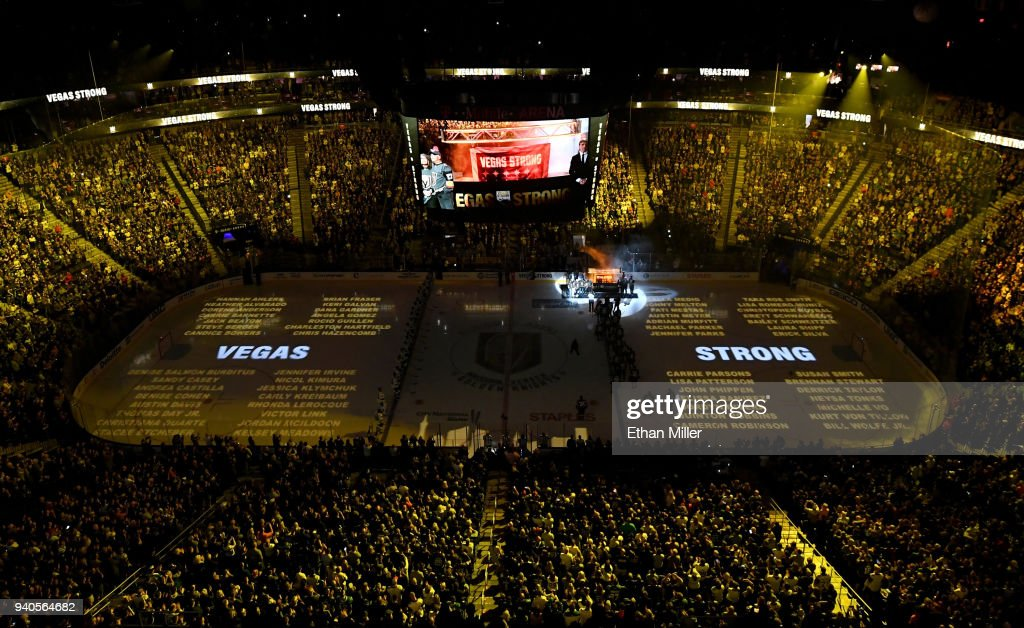 Names of the 58 victims of the October 1, 2017 mass shooting in Las Vegas are projected on the ice as the Vegas Golden Knights hang a banner in the rafters with 58 stars and the names of all the victims of the shooting as they retire the number 58 in honor of the 58 victims before a game against the San Jose Sharks at T-Mobile Arena on March 31, 2018 in Las Vegas, Nevada. The Golden Knights won 3-2 and clinched the Pacific Division title.