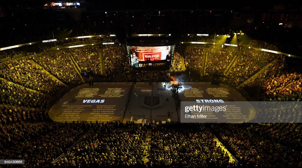 Names of the 58 victims of the October 1, 2017, mass shooting in Las Vegas are projected on the ice as the Vegas Golden Knights hang a banner in the rafters with 58 stars and the names of all the victims of the shooting as they retire the number 58 in honor of the 58 victims before a game against the San Jose Sharks at T-Mobile Arena on March 31, 2018 in Las Vegas, Nevada.
