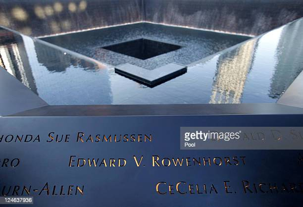 Names of the dead are seen along a 9/11 Memorial pool during the tenth anniversary ceremonies of the September 11 2001 terrorist attacks at the World...