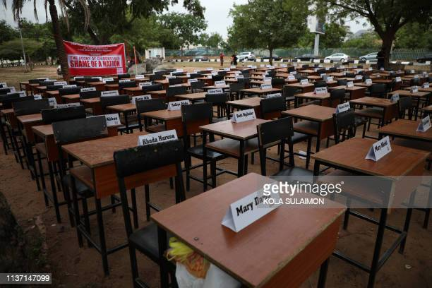 Names of the remaining Chibok schoolgirls are displayed with their desk on April 14 during the 5th Year Commemoration of the abduction of the 276...