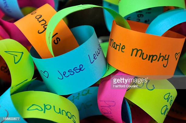 Names of the victims are written on a paper chain garland sent to the Connecticut Parent Teacher Student Association which is collecting snowflakes...