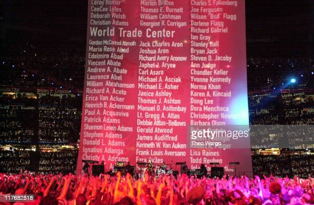 Names of the victims of the 9/11 attacks scroll up as U2 performs during the halftime show at Super Bowl XXXVI in the Superdome New Orleans Louisiana...