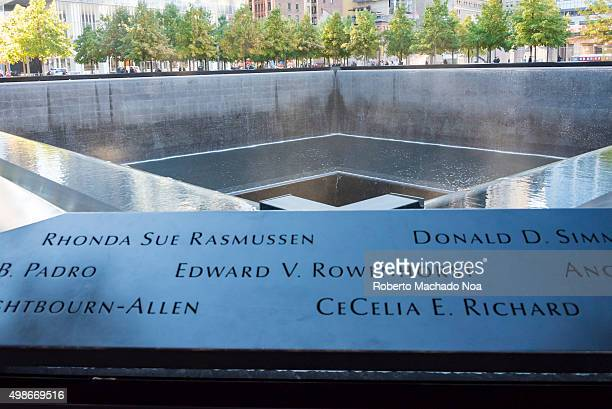 Names of victims carved at Ground Zero memorial or September 11 Memorial pool at the site of earlier World Trade Centre in New York city USA 9/11...