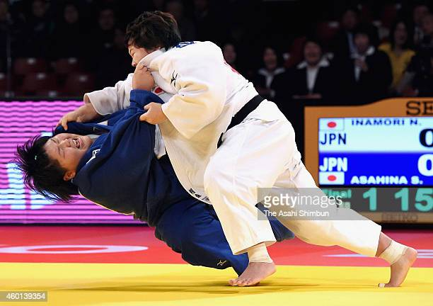 Nami Inamori of Japan throws Sara Asahina of Japan to win with an Ippon in the Women's 78kg final during day three of the Judo Grand Slam Tokyo 2014...