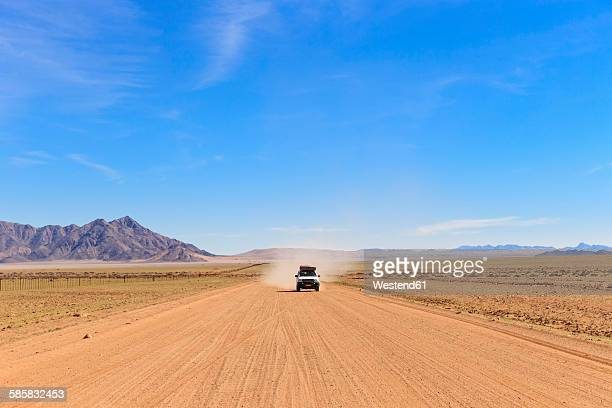 Namibia, cross country vehicle on gravel road 707