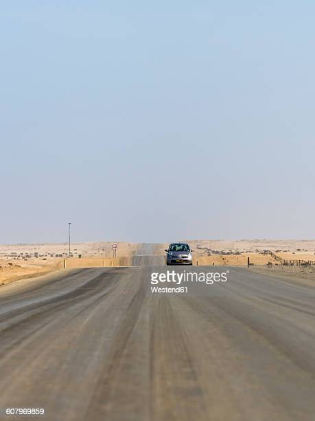 namibia, erongo region, cars driving on lonely coastal road c64 - erongo stock photos and pictures