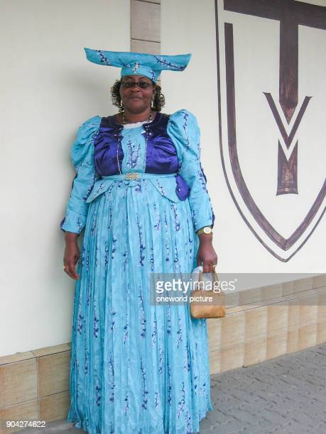 Namibia Erongo Swakopmund Herero woman in blue dress Herero woman with typical headdress