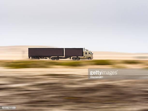 Namibia, Erongo, truck drivin fast on coastal road C34