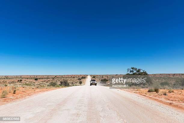Namibia, Kalahari, off-road vehicle driving on gravel road