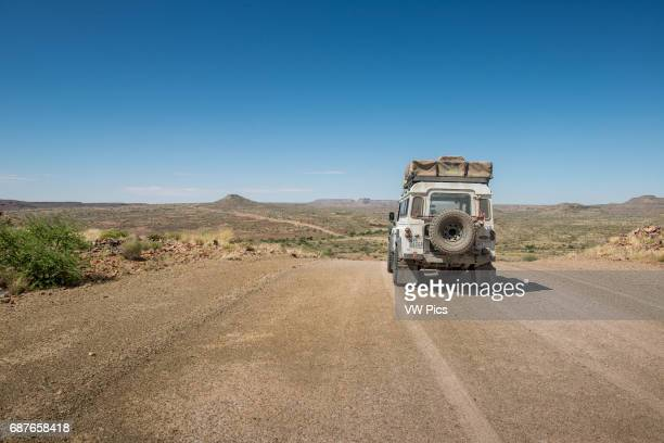 Namibia Land Rover driving down dirt road