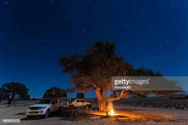 Namibia, Namib Desert, Namib Naukluft National Park, camping with camp fire by night