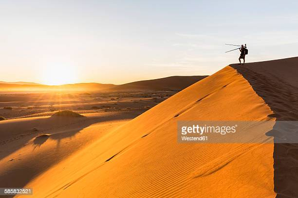 Namibia, Namib Desert, Namib Naukluft National Park, photographer standing on dersert dune