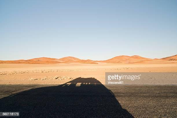 Namibia, Namib Desert, Namib Naukluft Park, shadow of a car driving through Sossusvlei