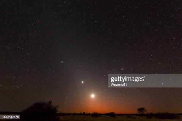 namibia, region khomas, near uhlenhorst, astrophoto, rising moon and planet venus embedded in glowing zodiacal light during dawn, constellation orion upside down - venus planet stock pictures, royalty-free photos & images