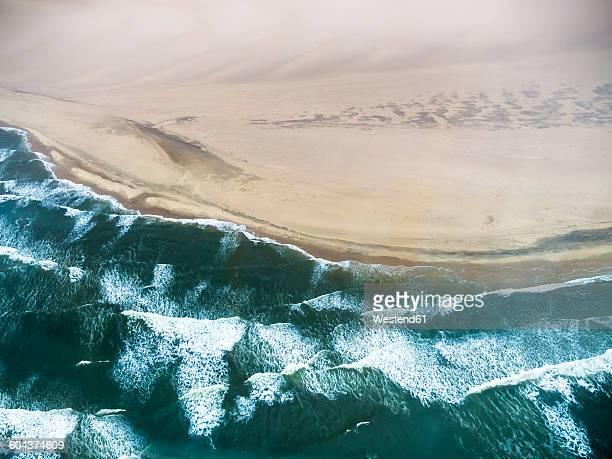namibia, walvis bay, atlantic meets namib desert, aerial view - walvis bay stock photos and pictures