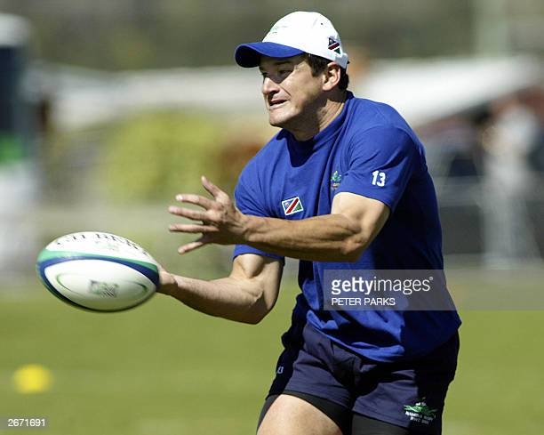 Namibian flyhalf Rudie Van Vuuren passes a ball during training at the South Launceston Football Club in Tasmania for the Rugby World Cup 2003 28...