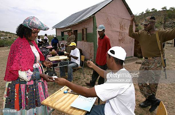 Namibian Herero woman is bout to cast her vote at the Ovanduvongwe polling station on the last day of Namibia's 2day presidential election in the...