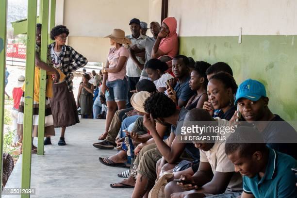 Namibians wait in line to vote in the Namibia general election at the Mandume Primary School polling station in Katutura Windhoek on November 27 2019