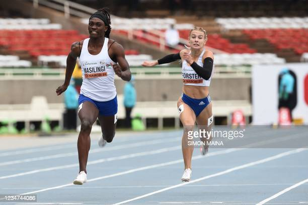 Namibia's Beatrice Masilingi places first in the semi-final of the women's 100m race as she competes with Slovakia's Viktoria Forster during the U20...