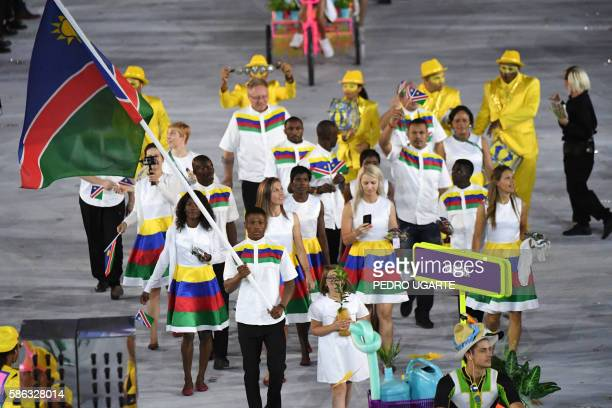 Namibia's flagbearer Jonas Junias Jonas leads his delegation during the opening ceremony of the Rio 2016 Olympic Games at the Maracana stadium in Rio...