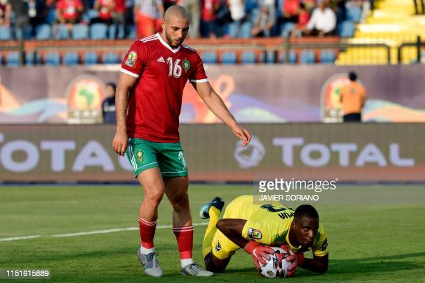 Namibia's goalkeeper Loydt Kazapua gathers the ball ahead of Morocco's forward Nordin Amrabat during the 2019 Africa Cup of Nations football match...