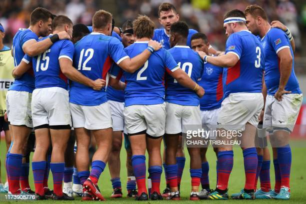Namibia's players huddle during the Japan 2019 Rugby World Cup Pool B match between New Zealand and Namibia at the Tokyo Stadium in Tokyo on October...