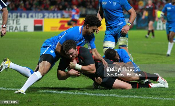 Namibia's Wacca Kazombiaze and TC Losper can not prevent Wales' George North from scoring a try
