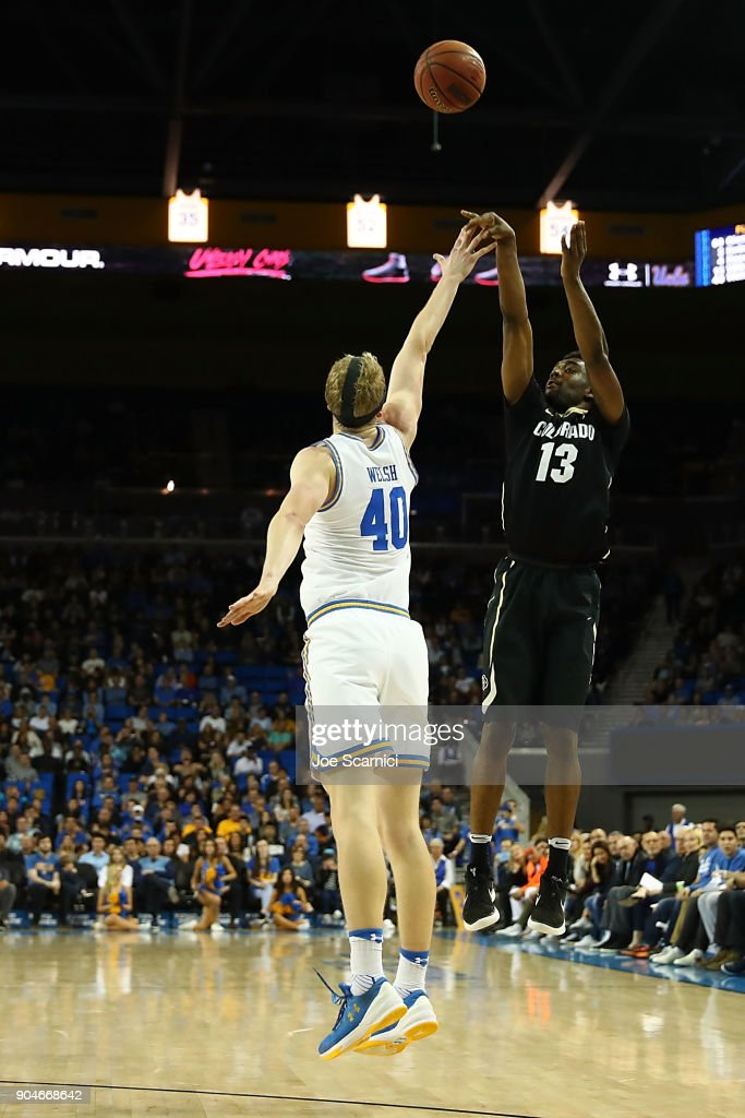 Namon Wright #13 of the Colorado Buffaloes shoots over Thomas Welsh #40 of the UCLA Bruins in the second half of the Colorado v UCLA game at Pauley Pavilion on January 13, 2018 in Los Angeles, California.