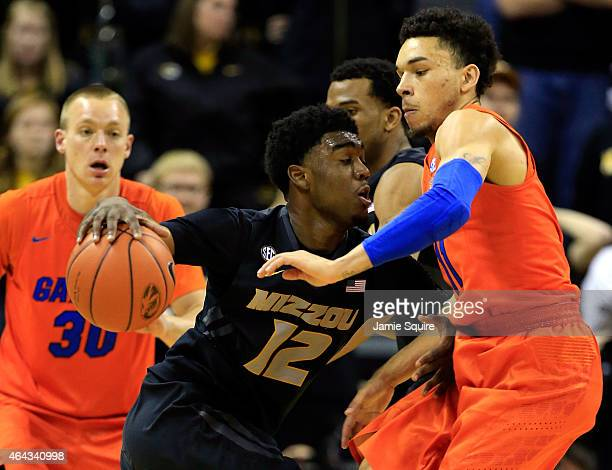 Namon Wright of the Missouri Tigers drives as Chris Chiozza of the Florida Gators defends during the game at Mizzou Arena on February 24 2015 in...