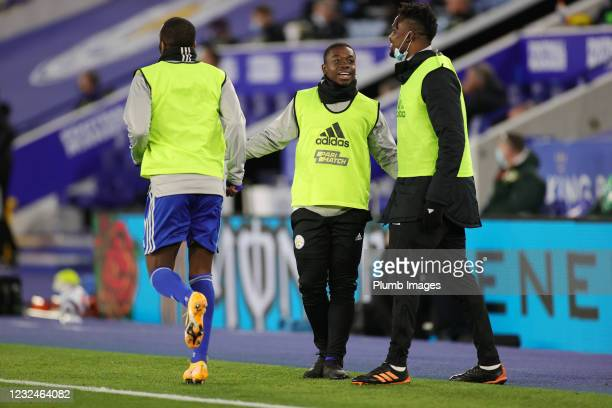 Nampalys Mendy of Leicester City and Daniel Amartey of Leicester City warm up from the bench during the Premier League match between Leicester City...